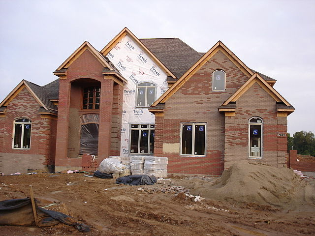 "A ""McMansion"" being built in Louisville, Kentucky. From https://flickr.com/photos/merfam/174212265/ courtesy Wikipedia Commons."