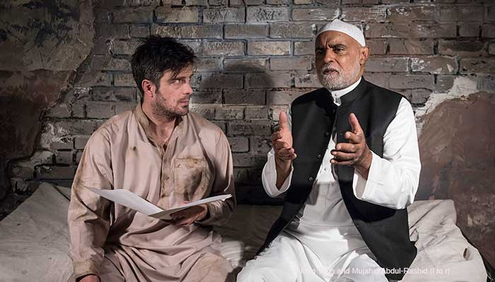 "John Tufts and Mujahid Abdul-Rashid in ETC's production of ""The Invisible Hand,"" photo by David Bazemore."