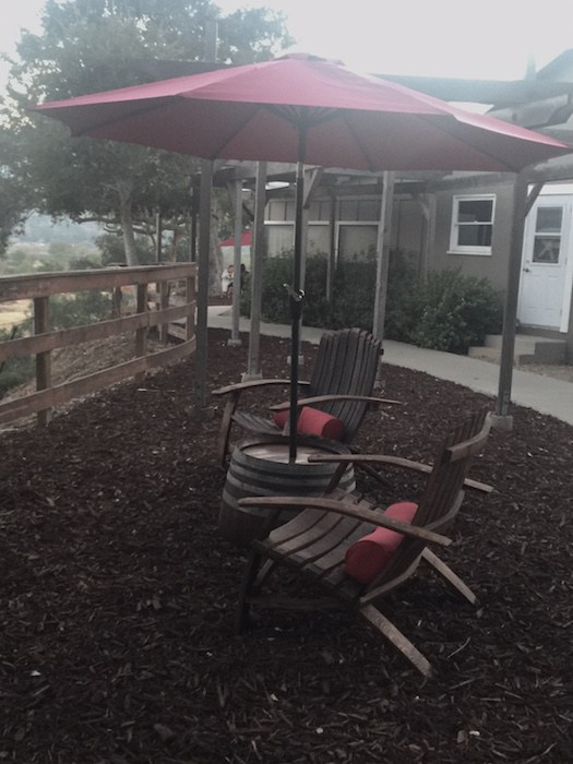 Outdoor seating at the Hitching Post Wine Tasting Room, photo by Leslie Dinaberg.