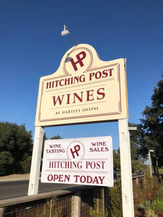 A sign welcomes visitors to the new Hitching Post Wine Tasting Room.