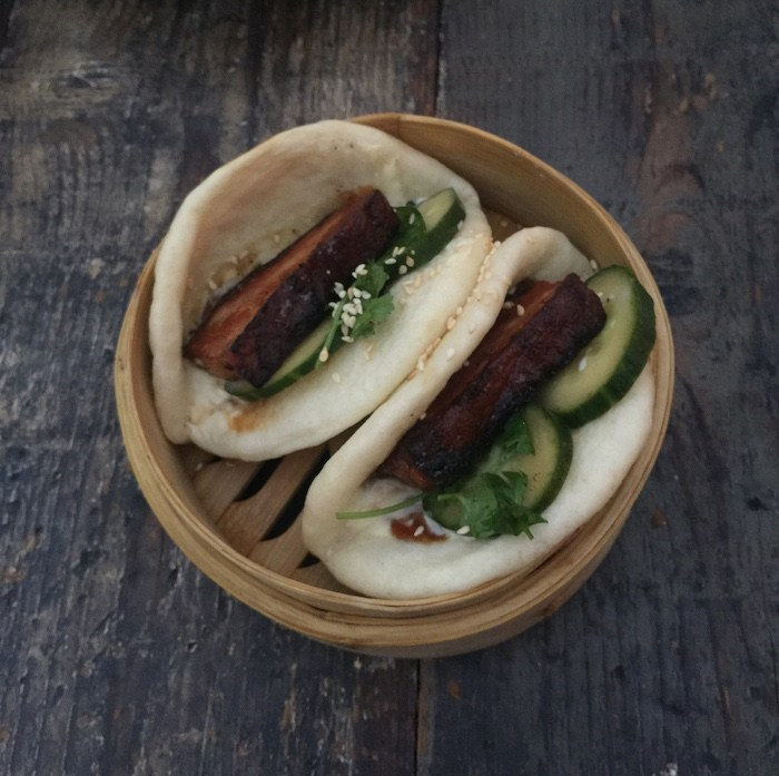 Outpost's Pork Belly Bao Buns with Pickled Cucumber, Jalapeno Kewpie, Sesame Seed, Cilantro and Hoisin Sauce, photo by Leslie Dinaberg