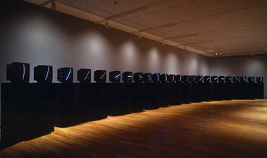 Nam June Paik, TV Clock, 1963/1989. Twenty-four fixed-image color television monitors mounted on 24 pedestals. SBMA, Museum purchase with funds provided by the Grace Jones Richardson Trust, Lillian and Jon B. Lovelace, Leatrice and Eli Luria and the Luria Foundation, Zora and Les Charles and the Cheeryble Foundation, Wendy and Elliot Friedman, and Lord and Lady Ridley-Tree.