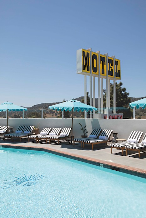 A restored vision of the iconic 1950s era pool and neon sign. Photo courtesy Skyview Los Alamos.