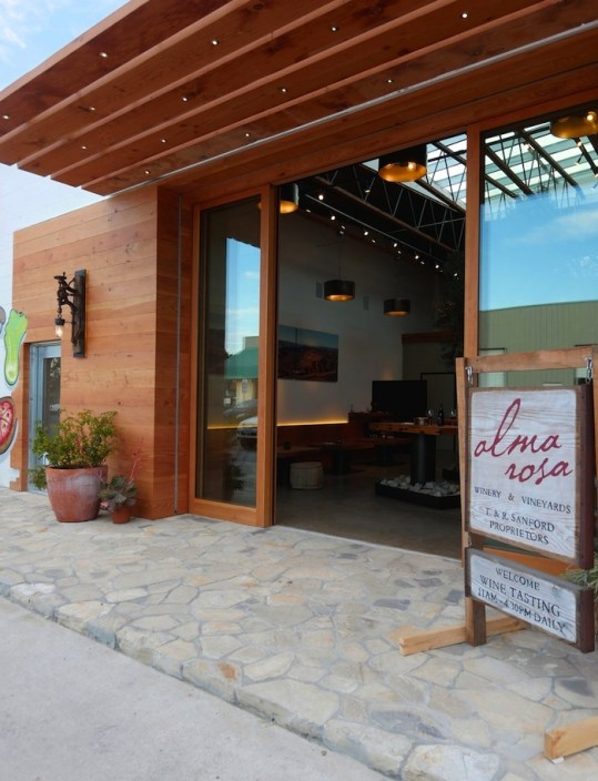 Alma Rosa's eco-chic tasting room in Buellton, built by Allen Construction, incorporates a 15-foot olive tree, local river stone and recycled Douglas Fir. Photo by Patrick Price.