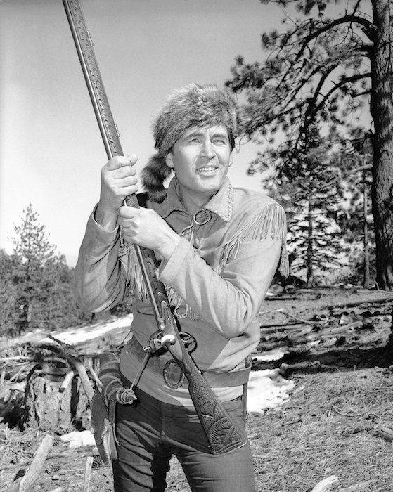 "From coonskin cap to coonskin cap in one decade is the career of Fess Parker, shown in his costume as ""Daniel Boone,"" March 26, 1964. Ten years ago he played Davy Crockett in a series by the same name. (AP Photo)"
